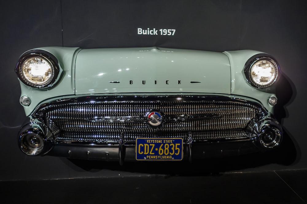 white classic car in a dark room
