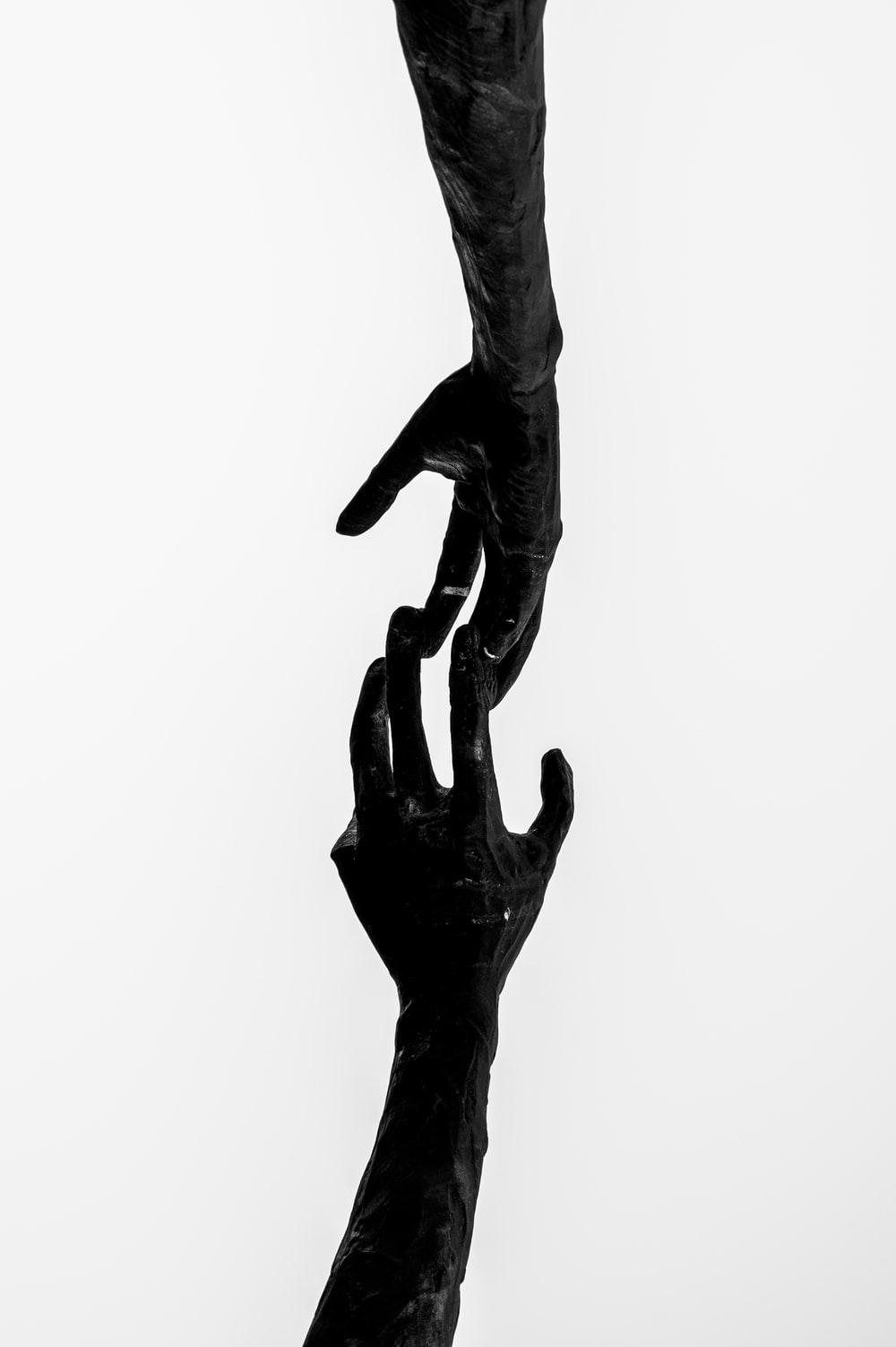 black and white human statue