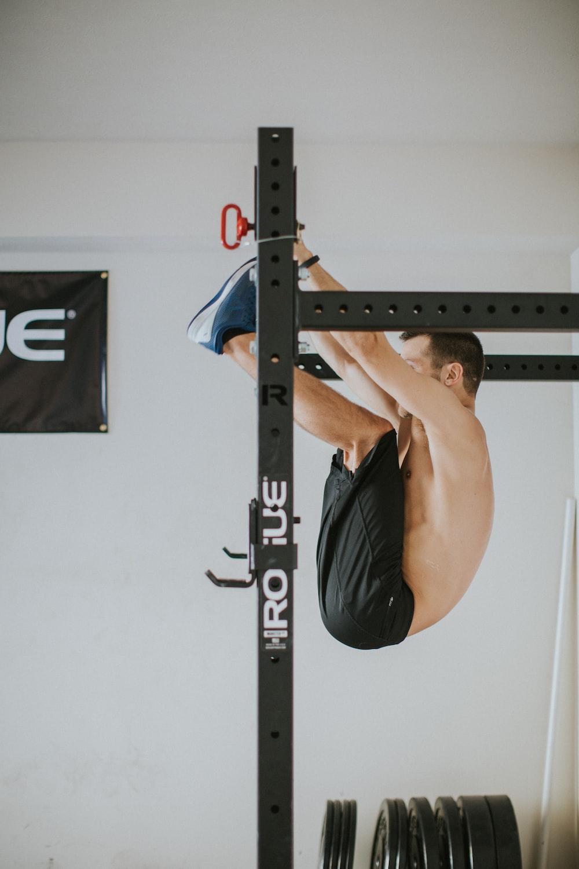 man in black shorts doing exercise