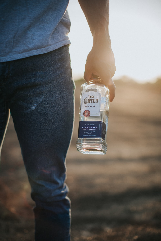 person holding white plastic bottle