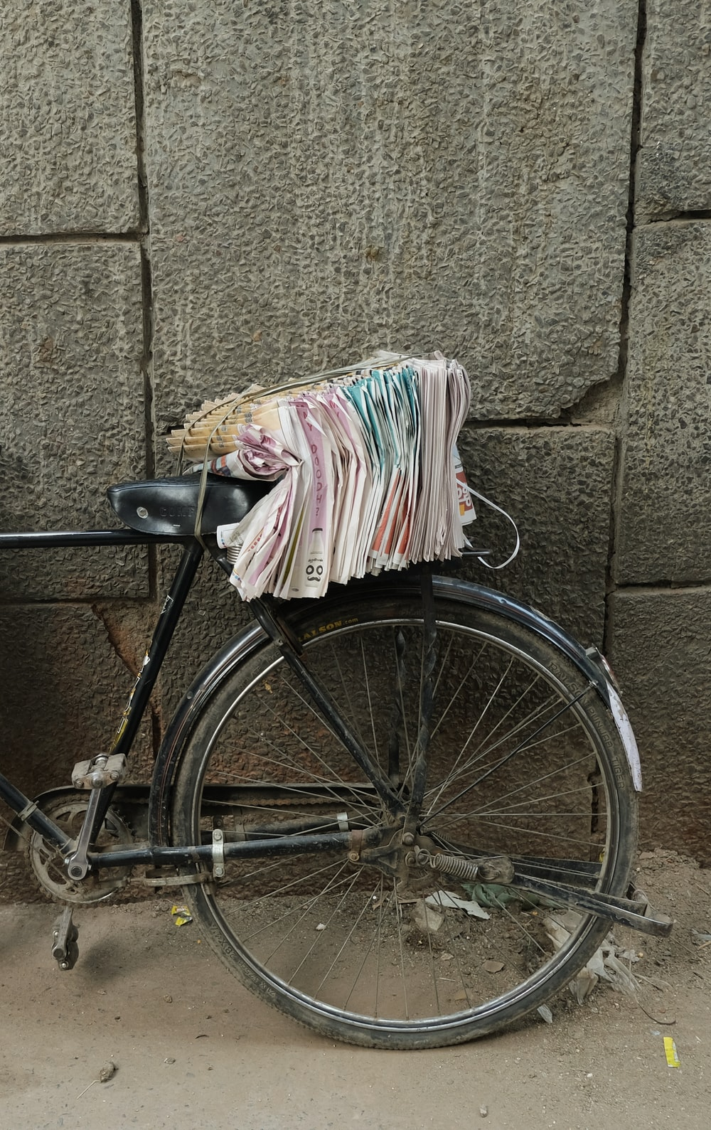 black bicycle with white and pink textile on it