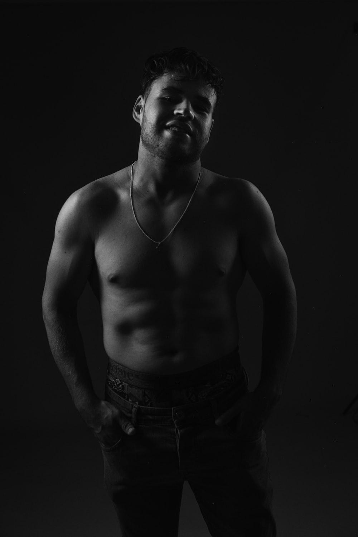 topless man wearing denim jeans