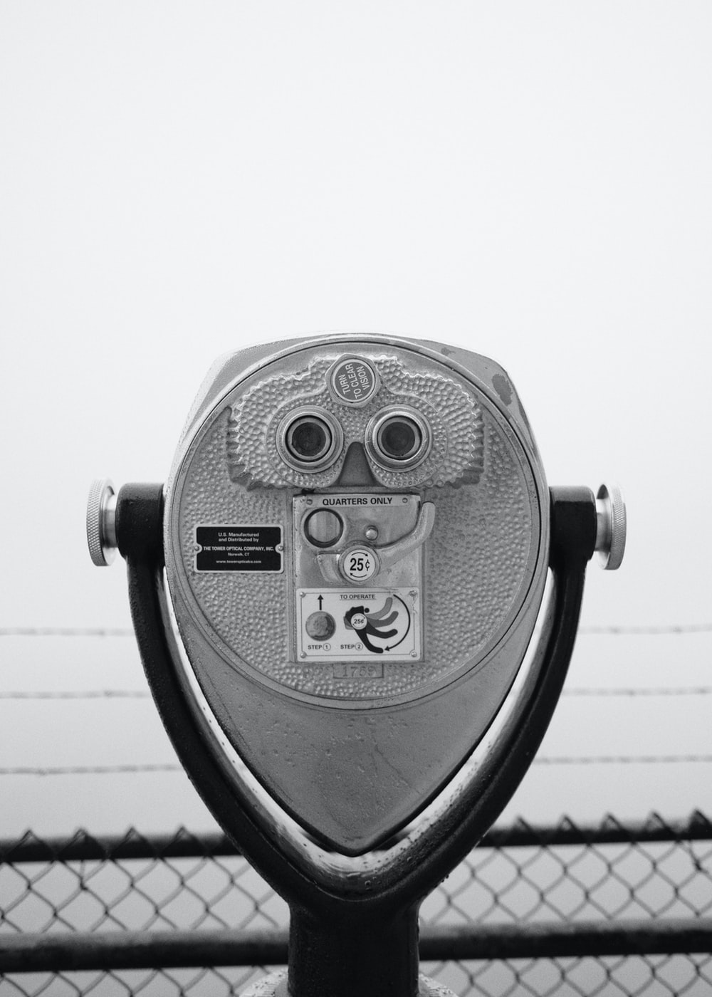 gray coin operated binoculars on white background