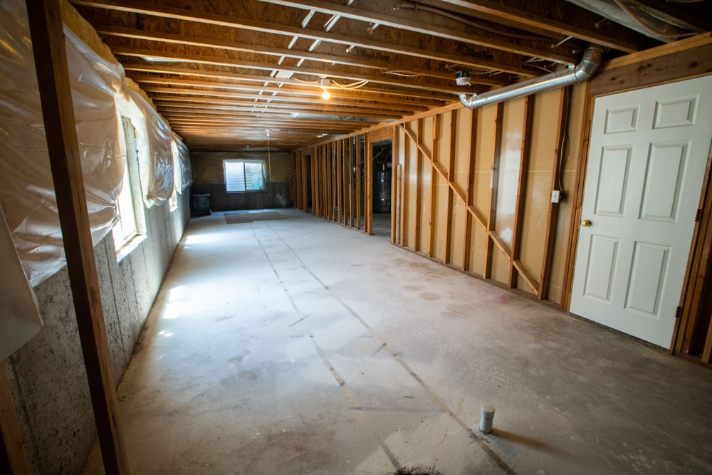 brown wooden door near white wall