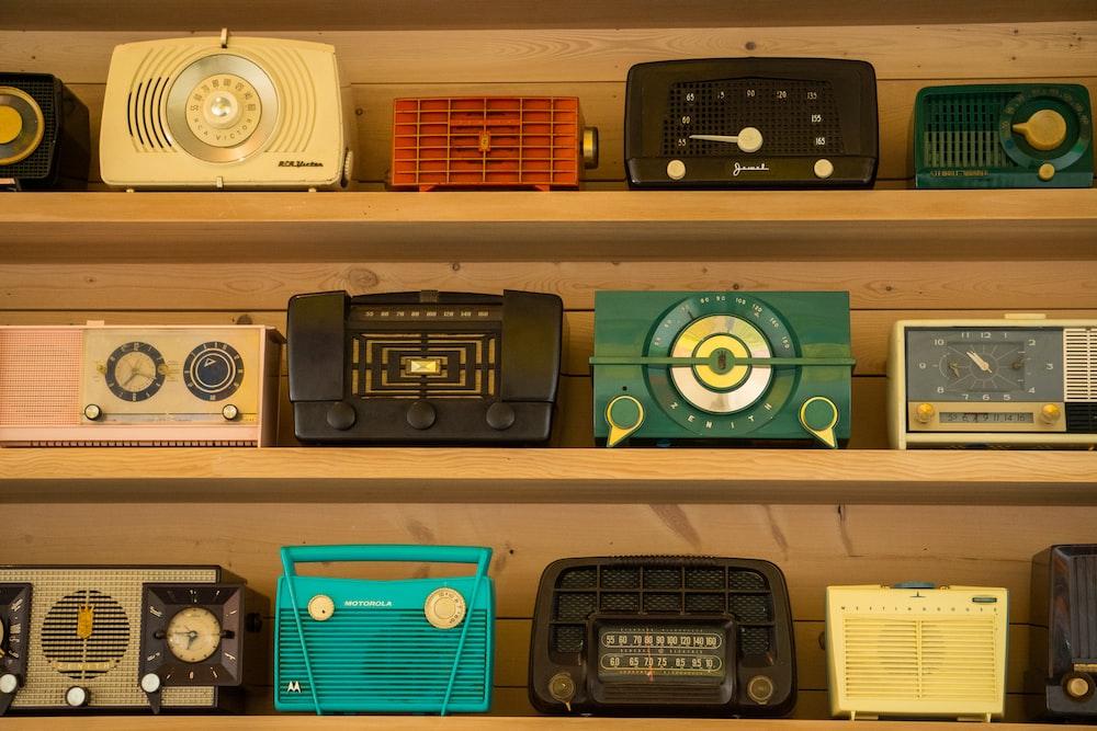 black radio on brown wooden shelf