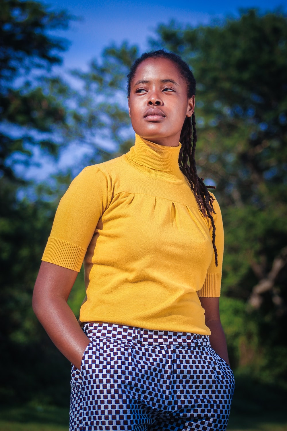 woman in yellow crew neck t-shirt and black and white polka dot skirt