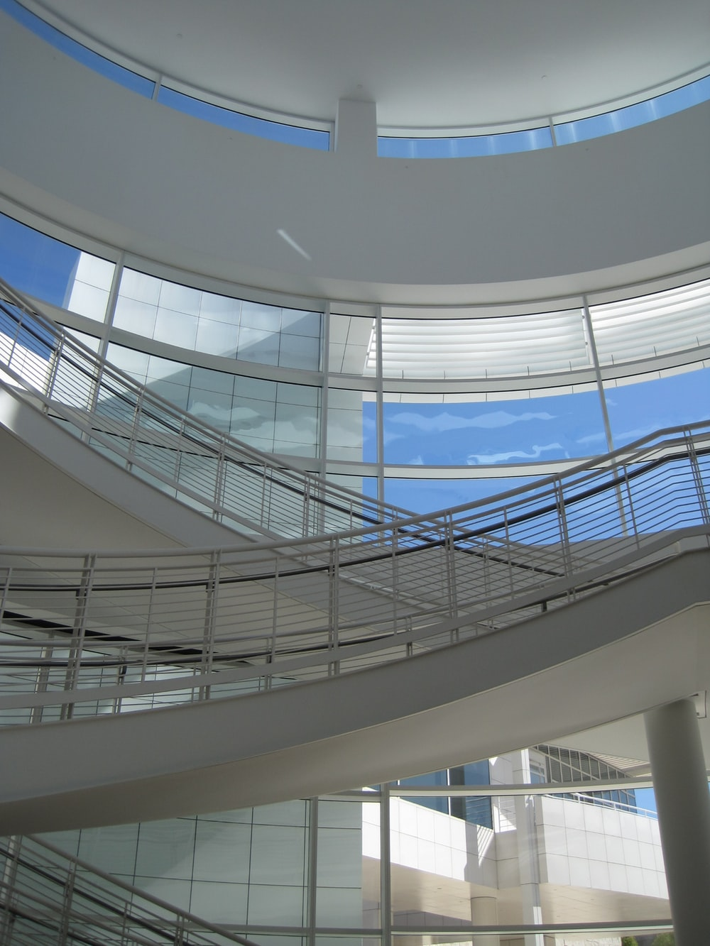 white spiral staircase with blue railings