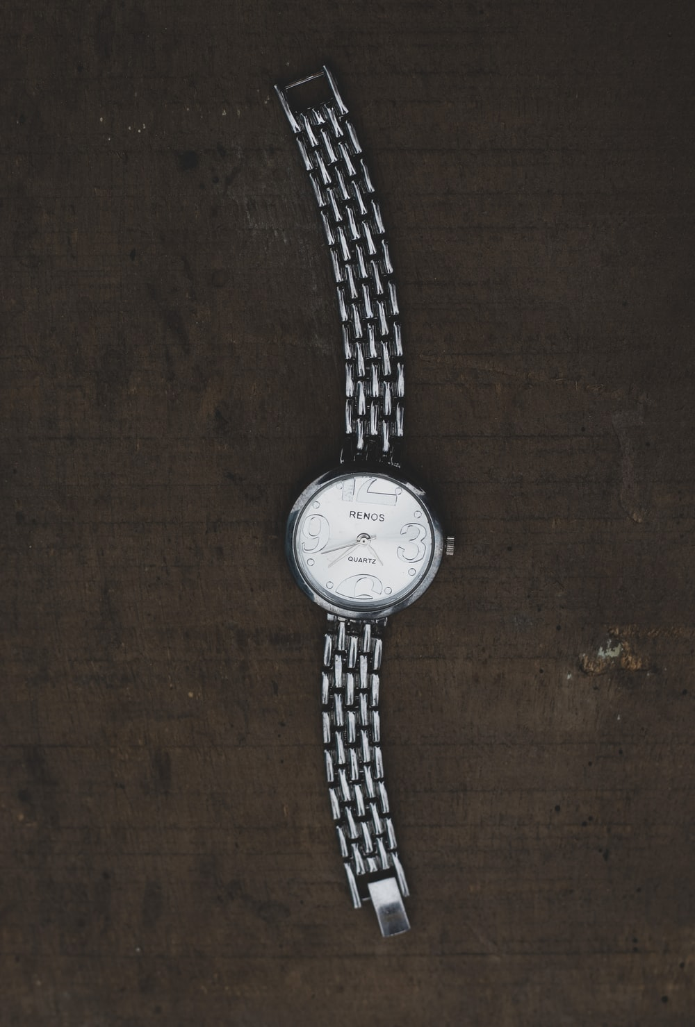 silver round analog watch with silver link bracelet