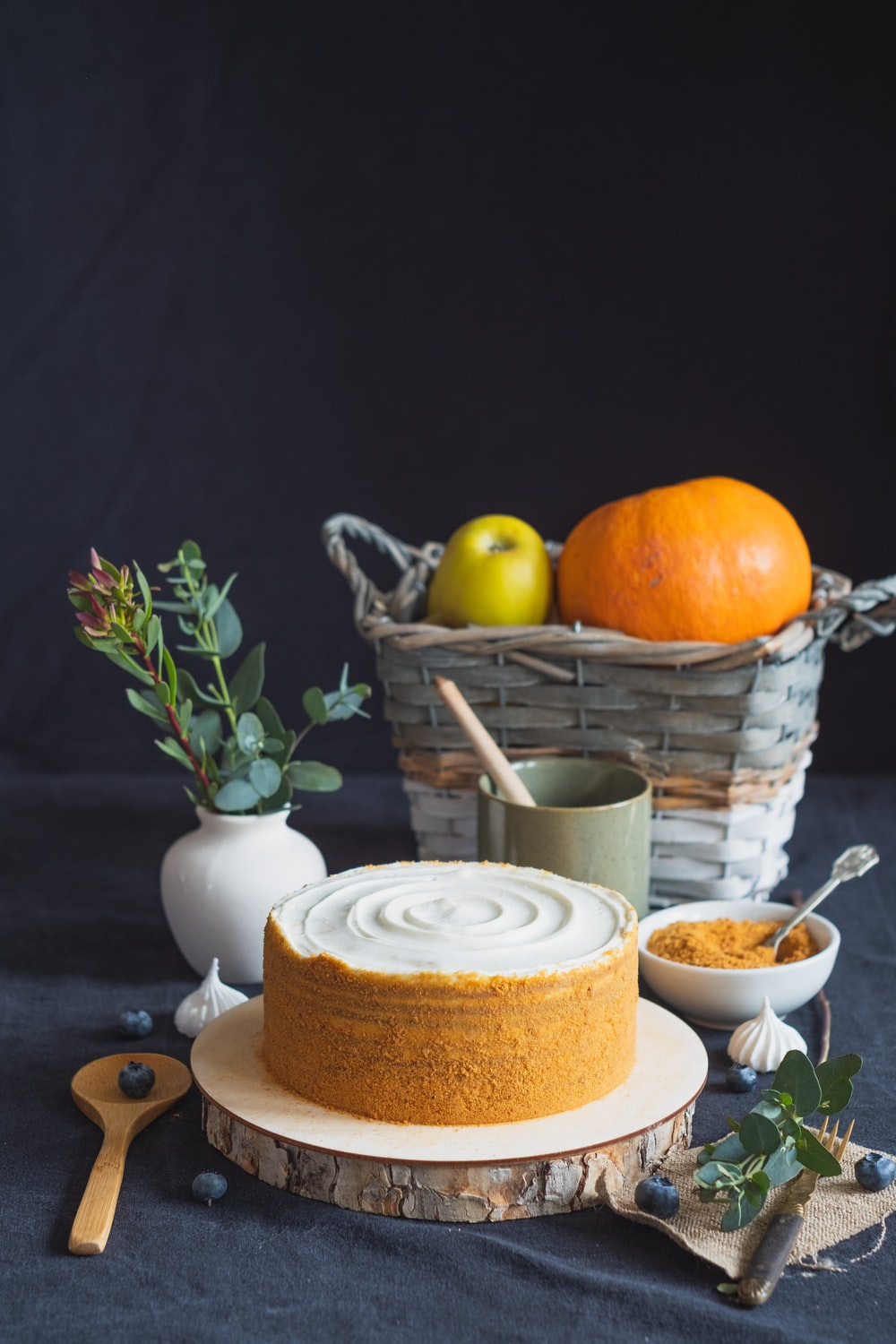 orange fruit on white ceramic plate beside white ceramic cup with saucer