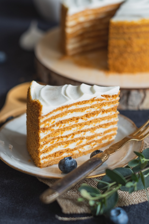 sliced of cake on white ceramic plate