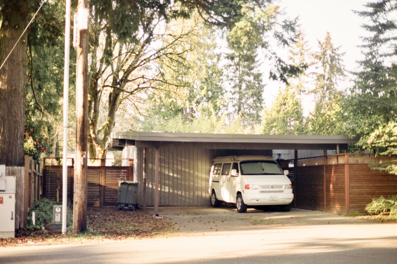 white van under a carpot