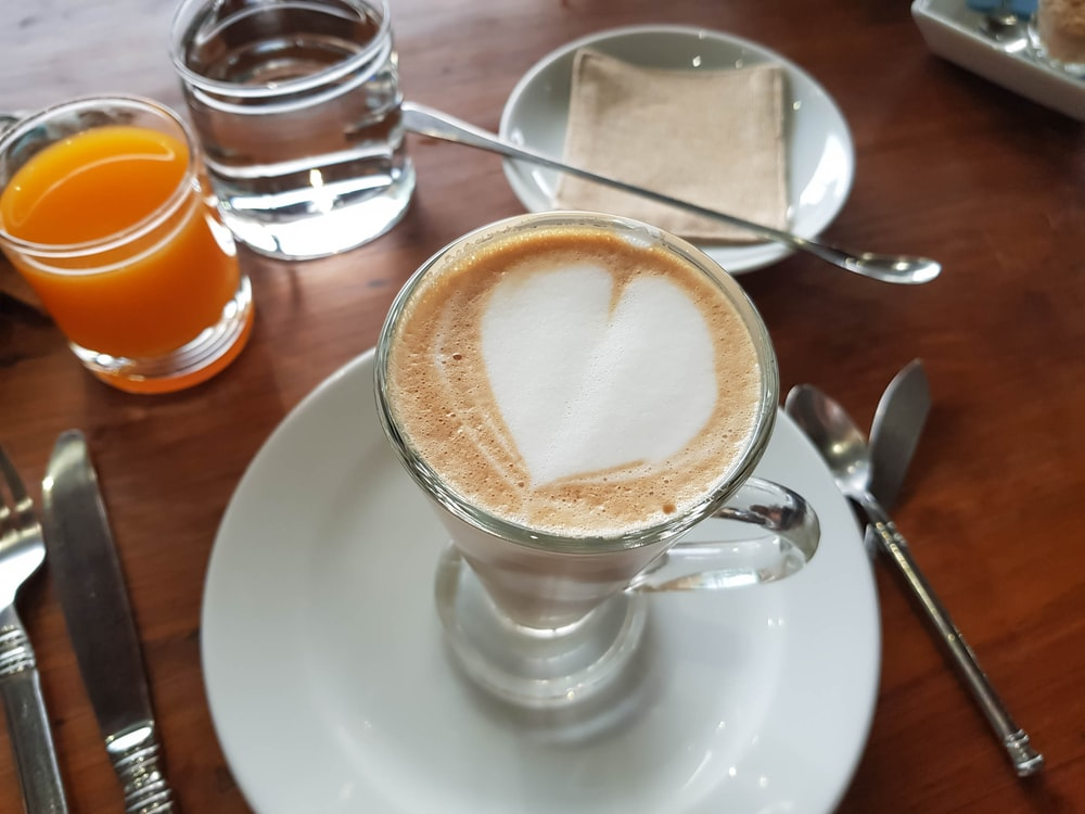 white ceramic cup with cappuccino