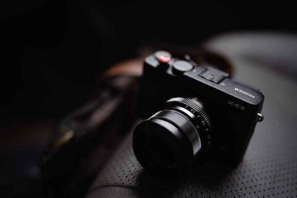 black sony camera on black textile