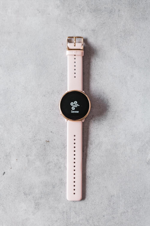 white and black round digital watch