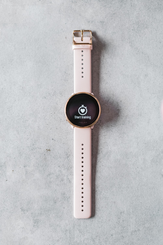 white and black round analog watch