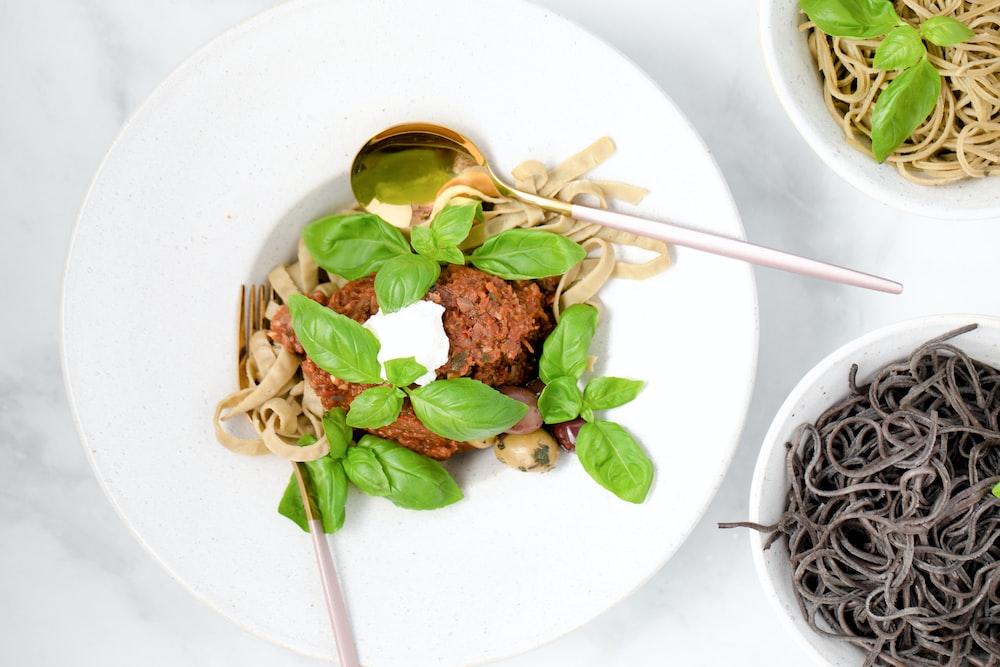 white ceramic bowl with noodles and chopsticks