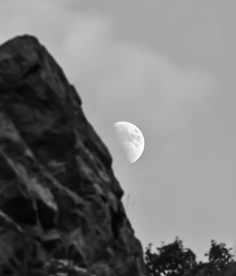 grayscale photo of moon in the sky