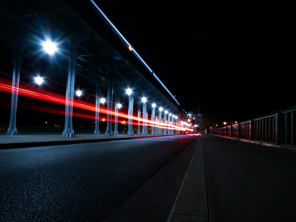 red and white bridge during night time