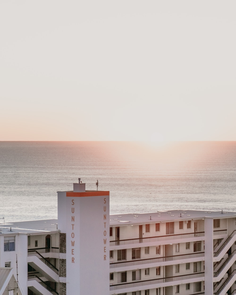 white concrete building near sea during daytime