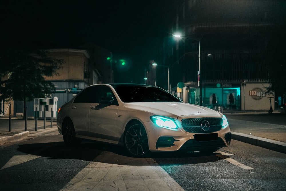silver mercedes coupe on road during night time