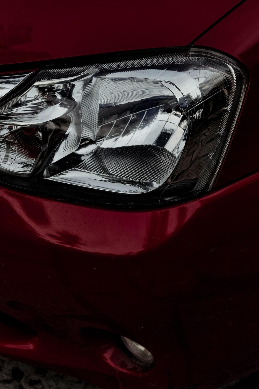 red car with broken mirror