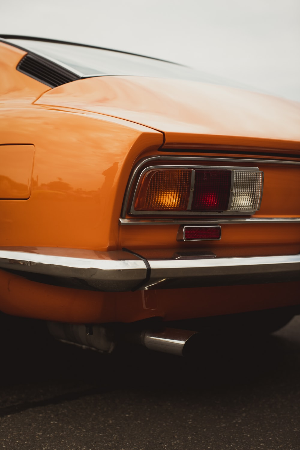 orange car with white and black lights
