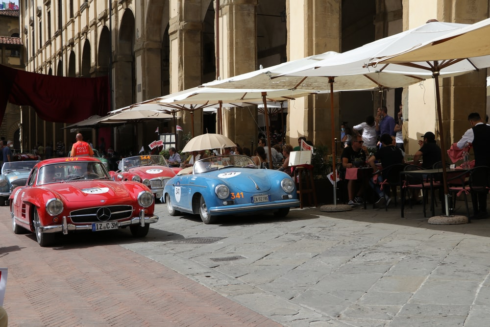 blue and red car on street during daytime