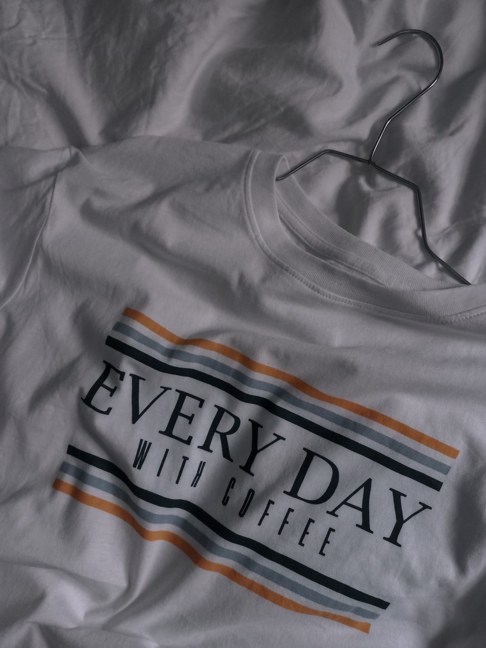 gray and orange crew neck shirt