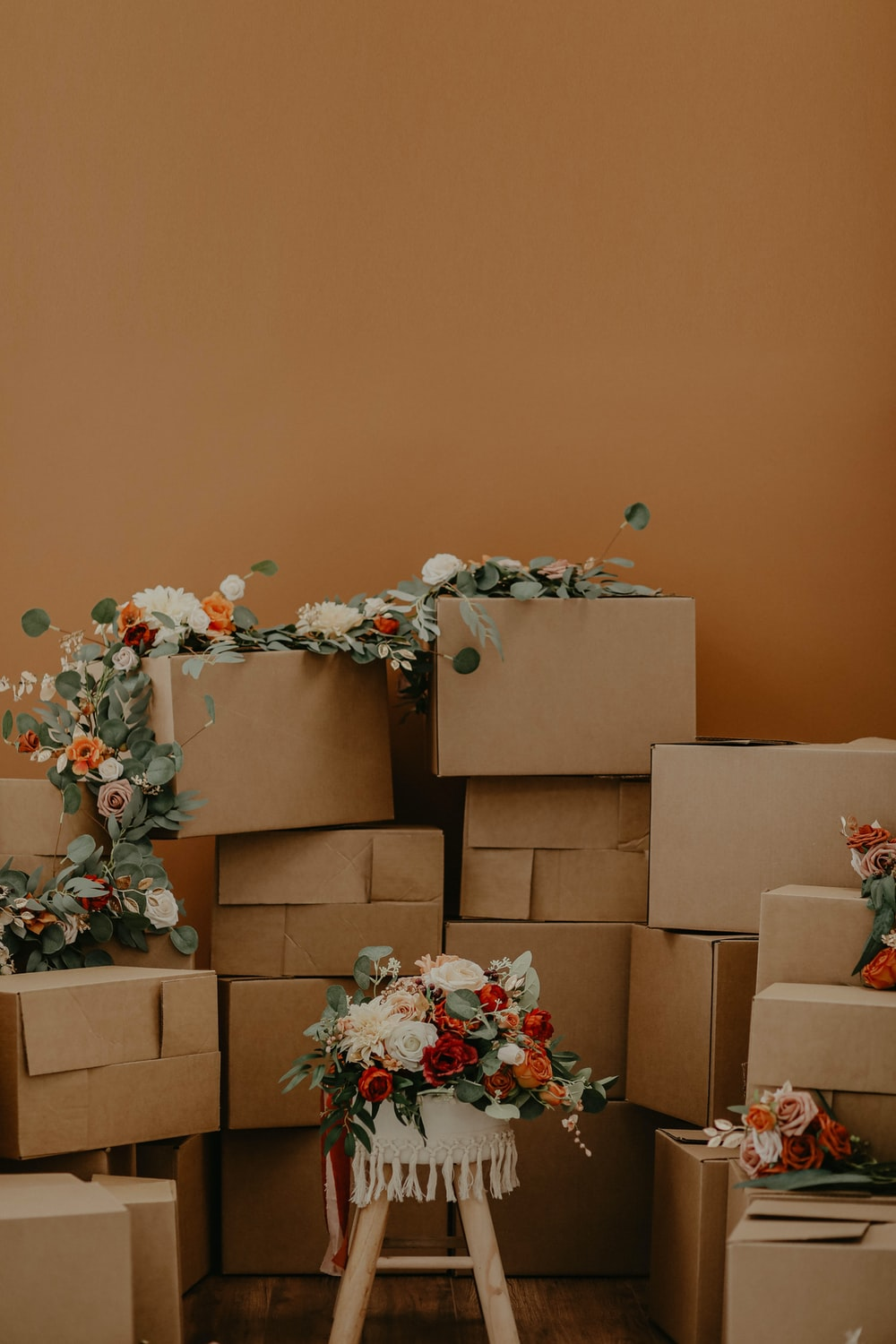 white and red flowers on brown cardboard boxes