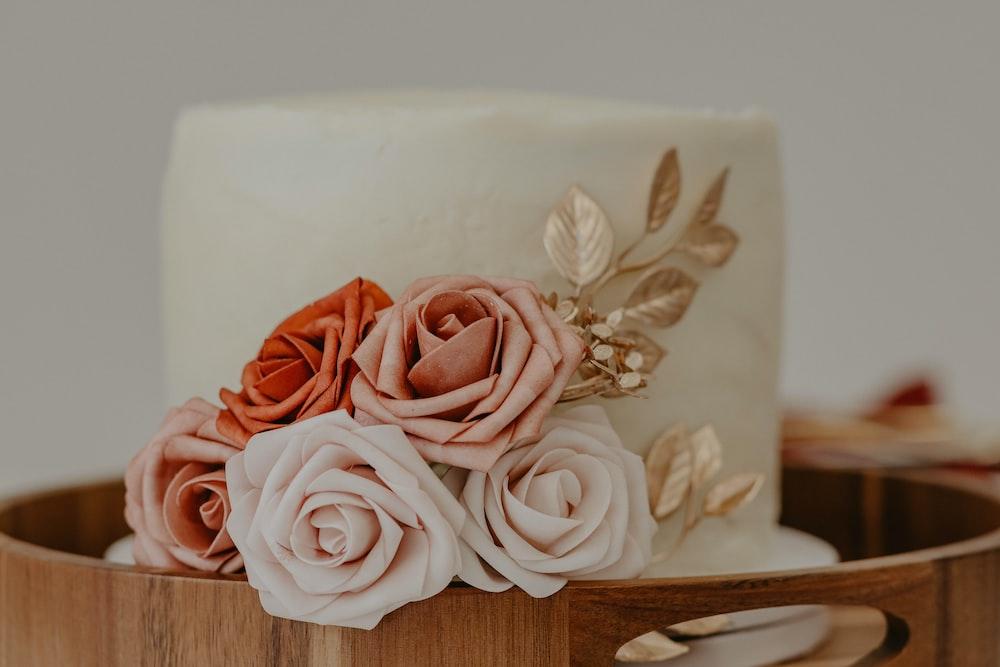 pink roses on white ceramic vase
