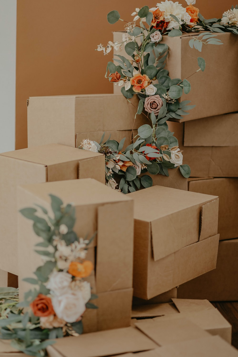 brown cardboard box with green and red flowers