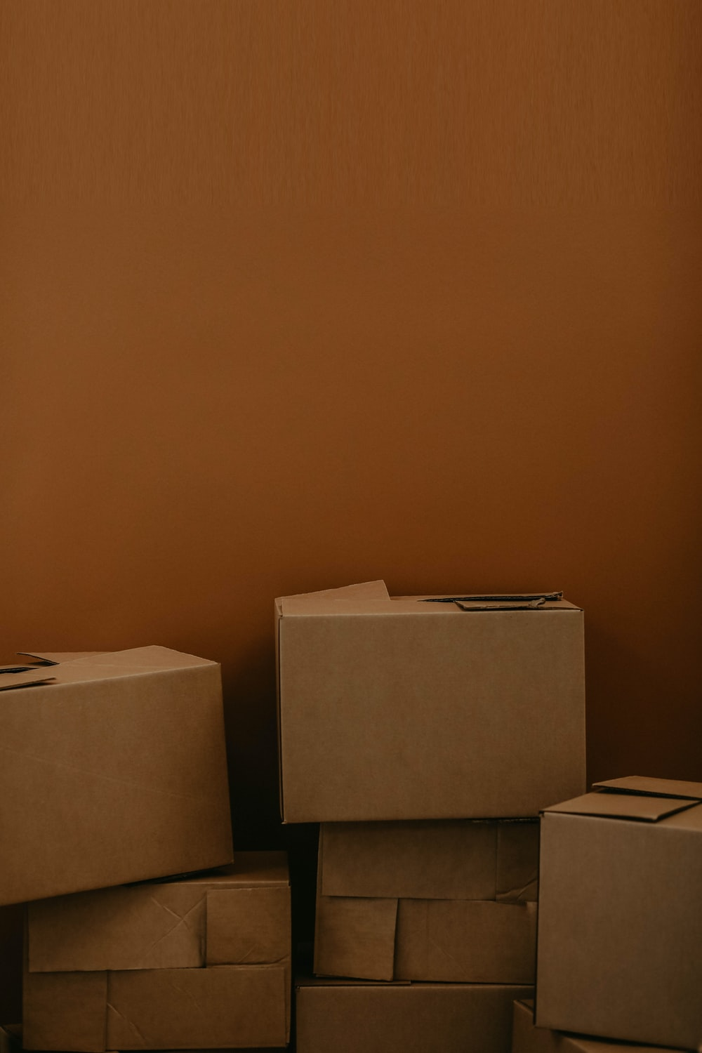 white cardboard box on brown wooden table