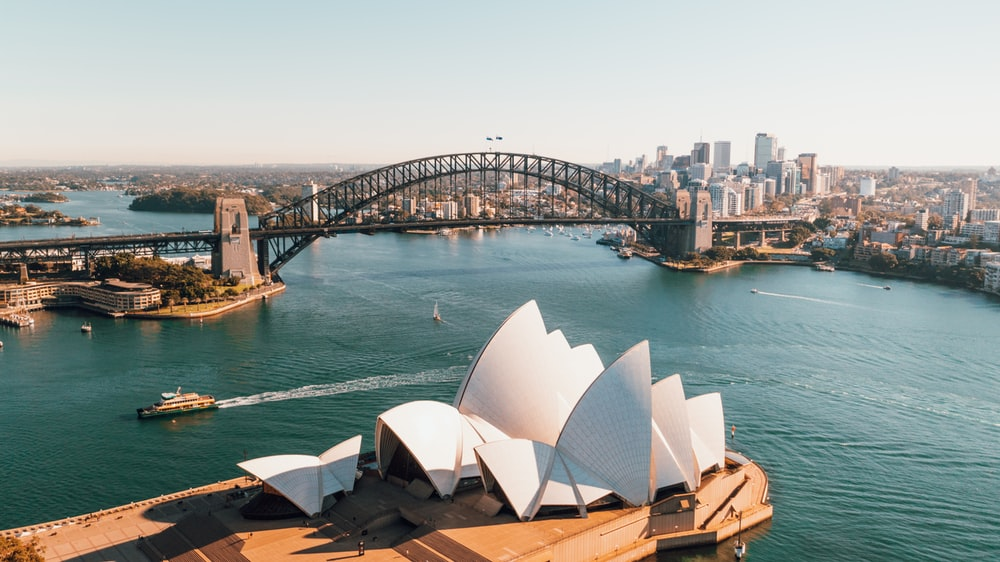 sydney opera house near body of water during daytime