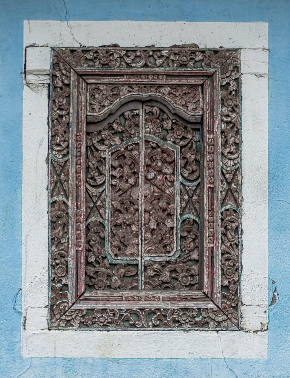 brown and green wooden door