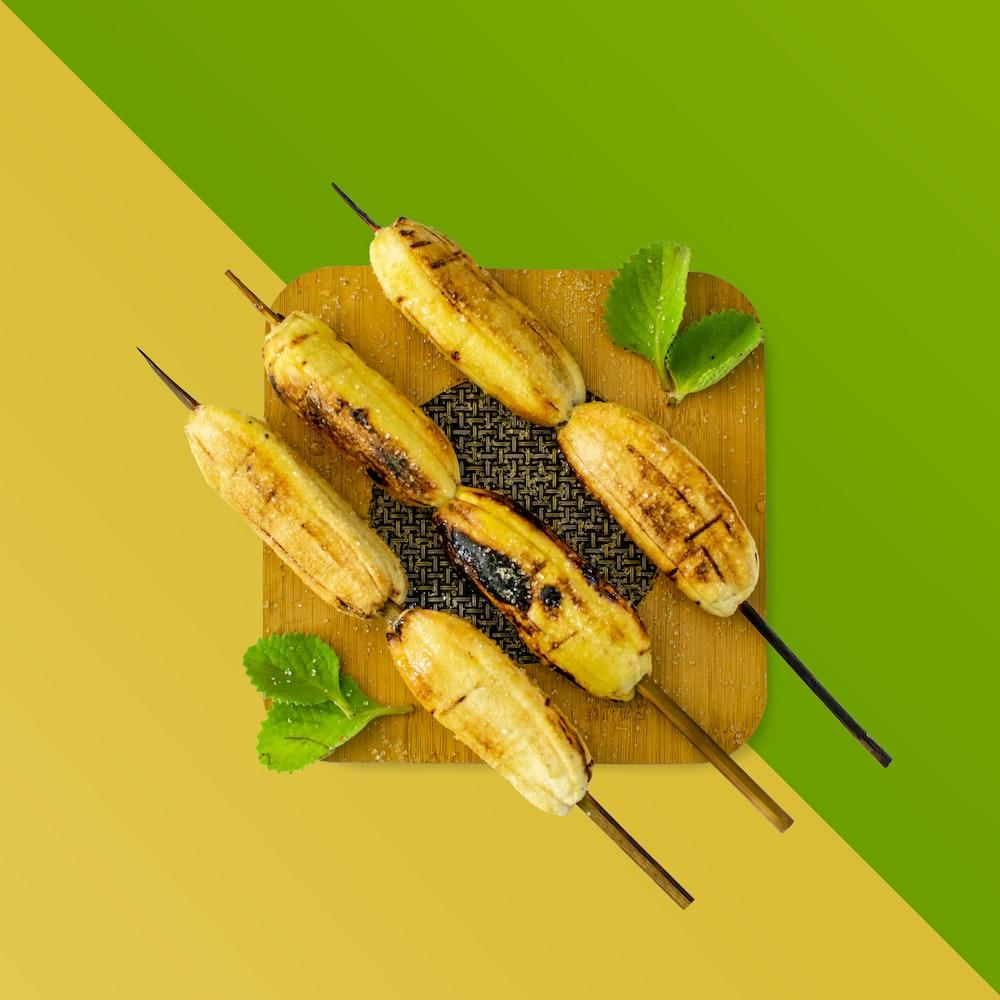 grilled banana on green leaf