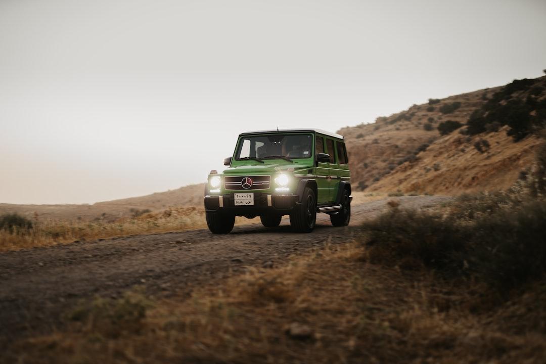 Green Car On Brown Field During Daytime - unsplash