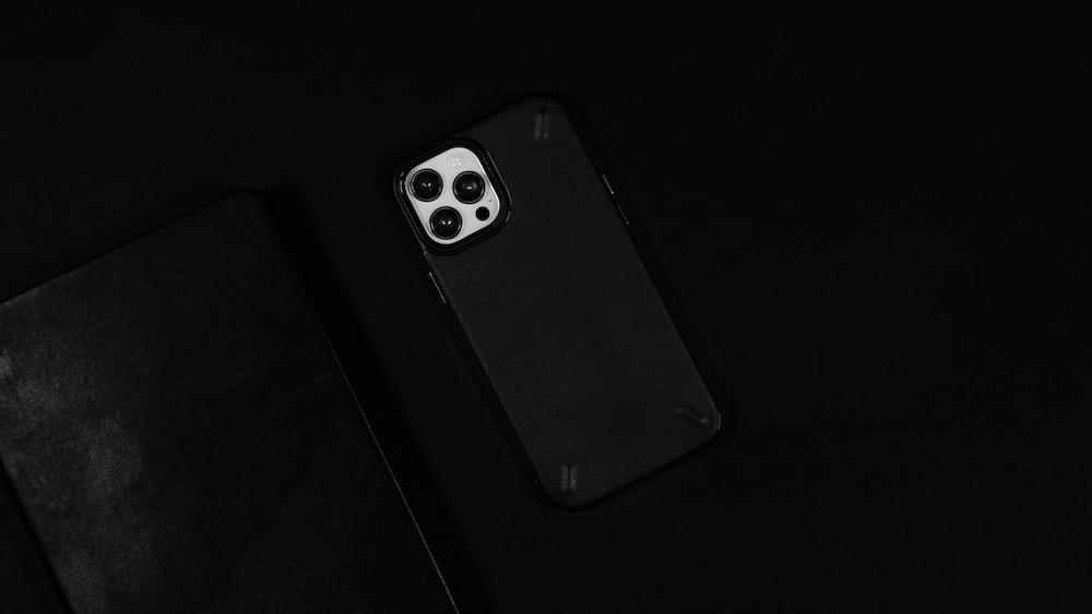 black iphone 4 on black background