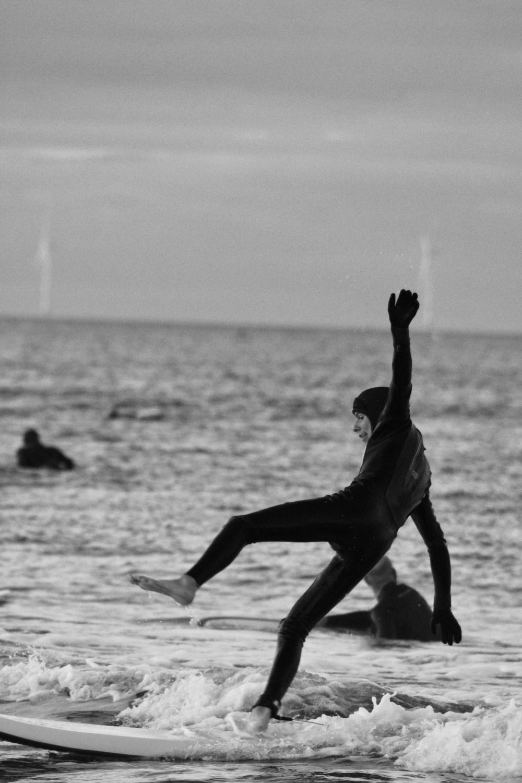 woman in black dress on water