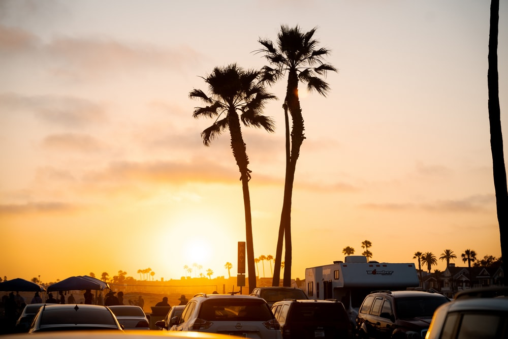 cars parked on parking lot during sunset