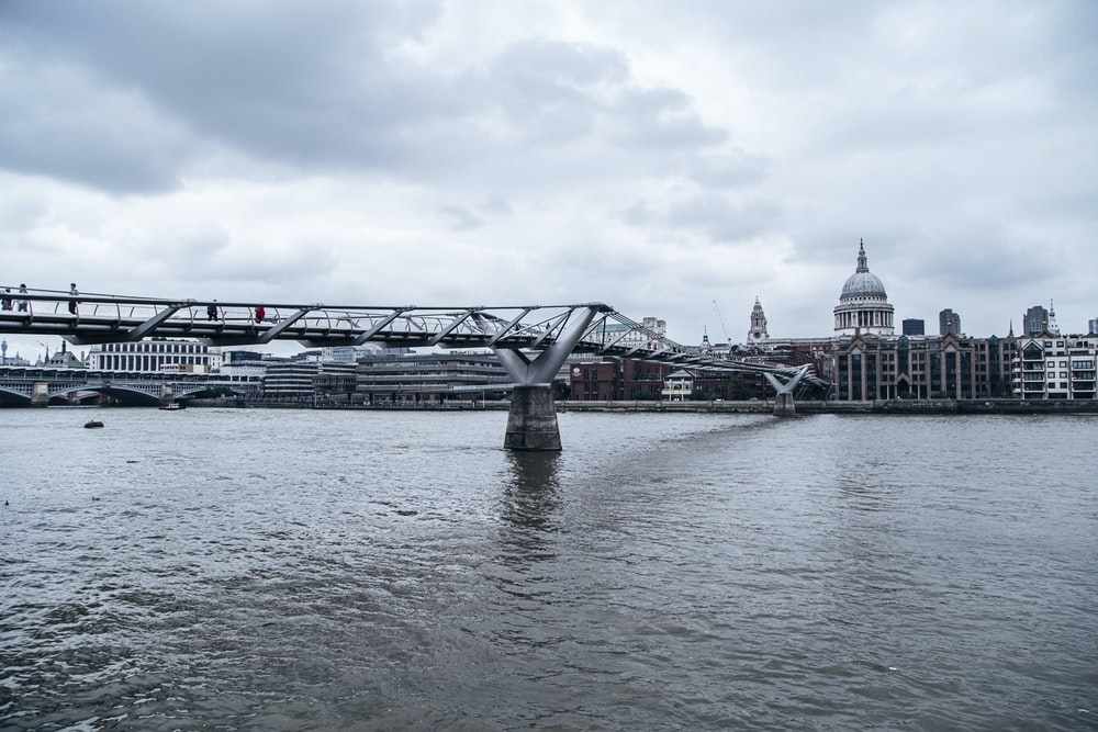 gray bridge over body of water during daytime