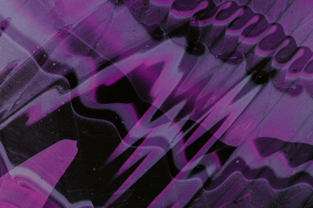 purple and white textile in close up photography