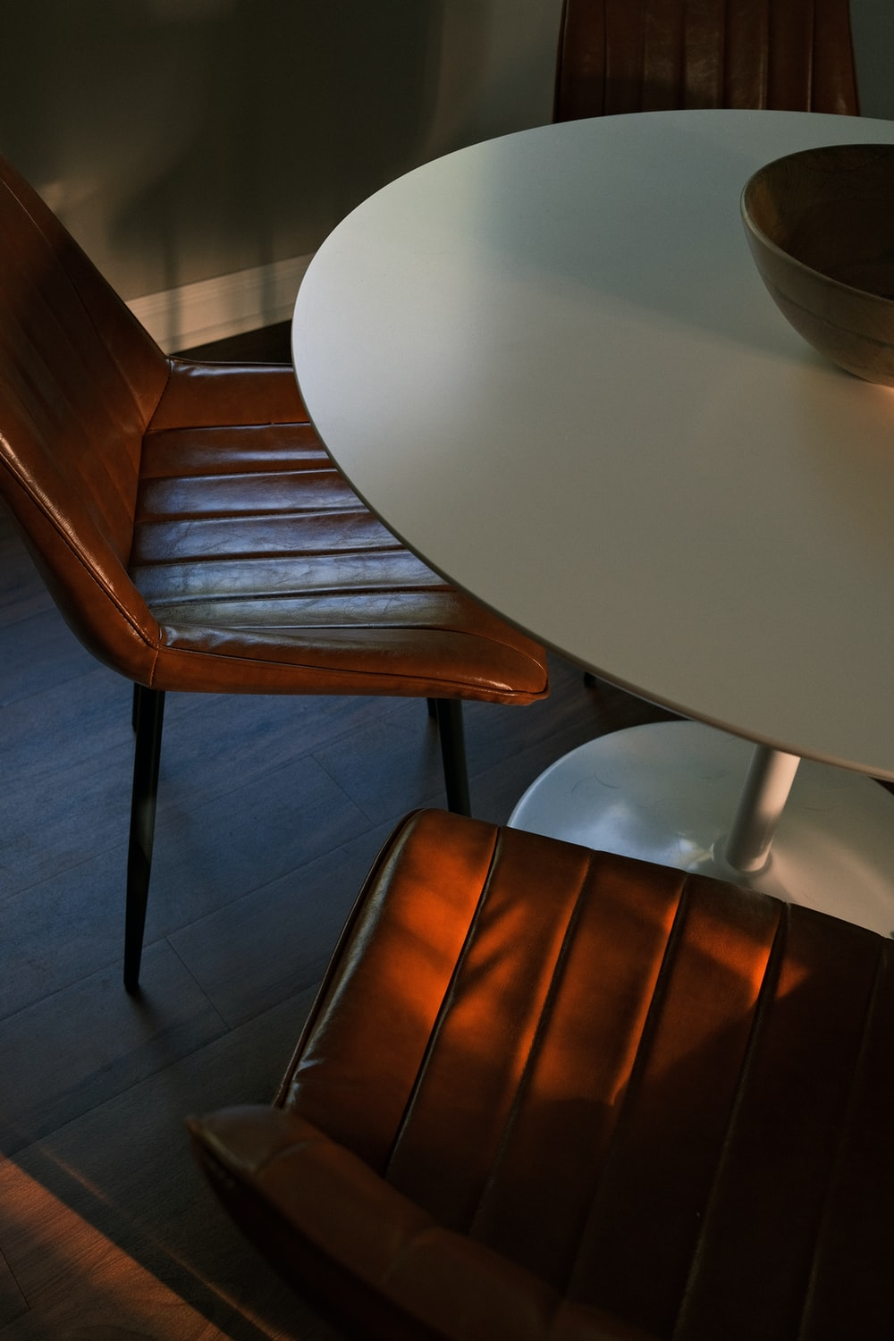 brown wooden chair beside white table