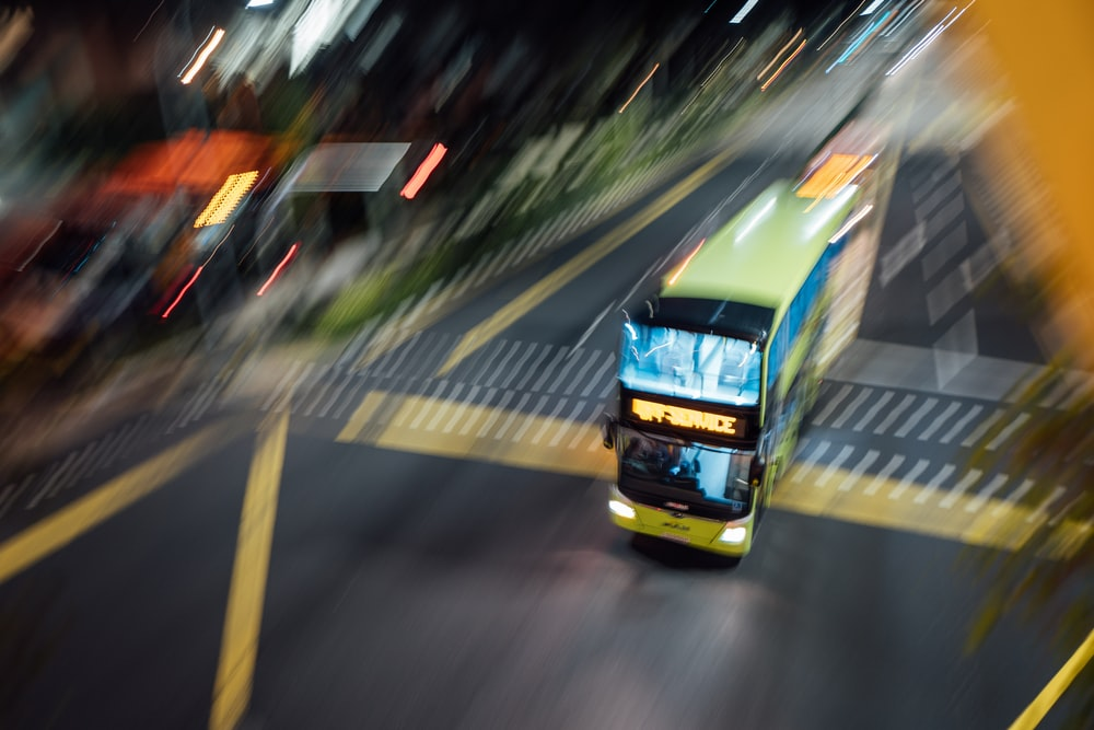 yellow and blue bus on road during daytime