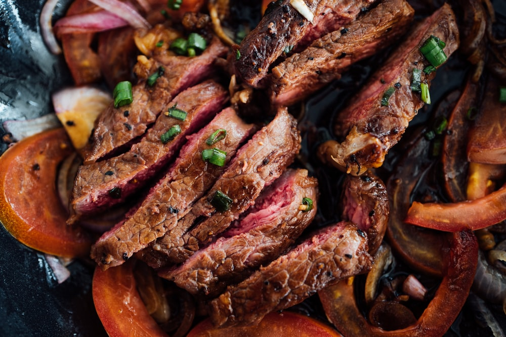 grilled meat on brown wooden chopping board