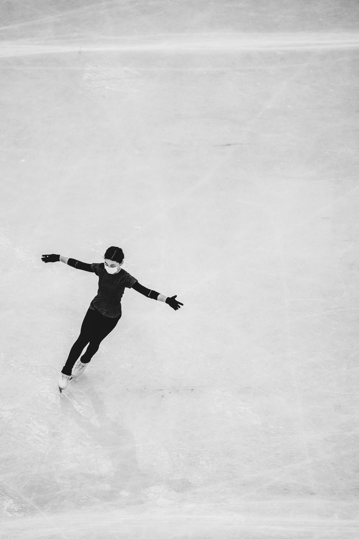 man in black shirt and pants walking on white floor