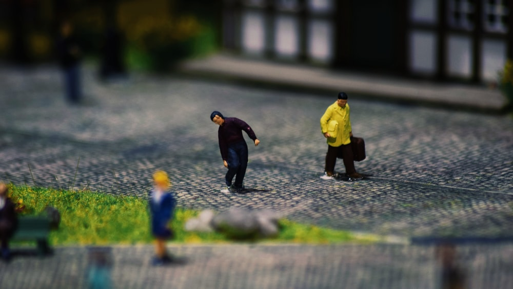 2 boys walking on the street
