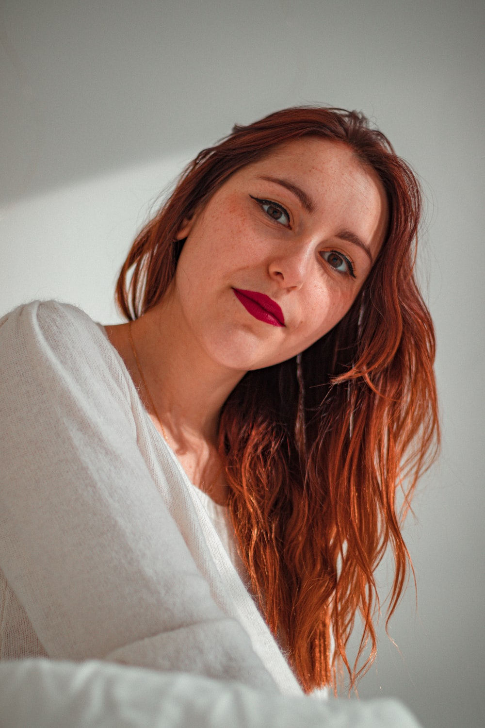 woman in white shirt with red hair