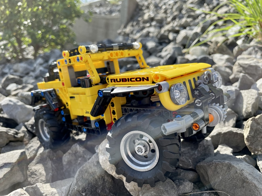 yellow and black tractor on gray rock