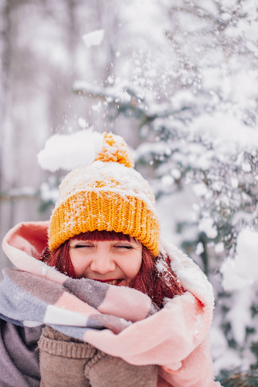 girl in white winter coat and brown knit cap
