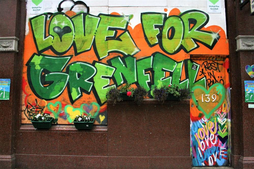 green and yellow graffiti on wall